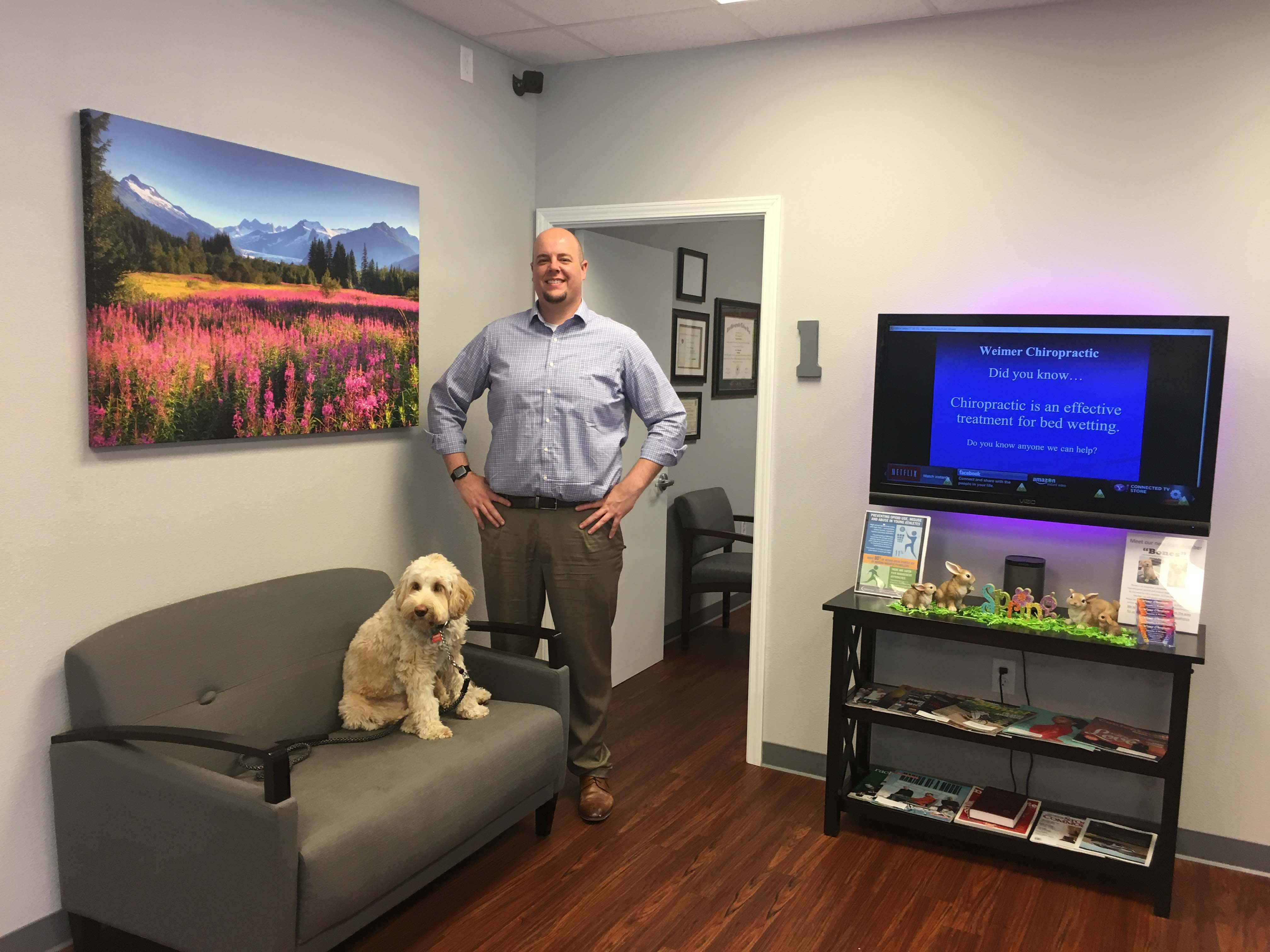 Dr. Weimer is our Senior Chiropractor.  Bones is our service dog,